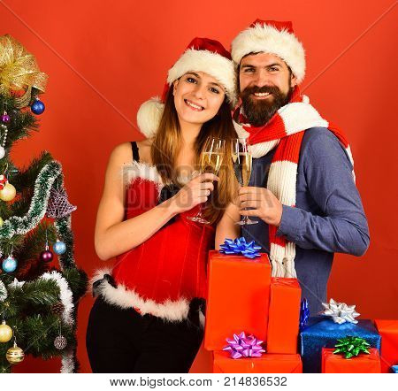 Santa And Sexy Girl With Drinks. Mister And Missis Claus