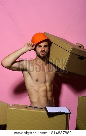 Guy With Naked Torso Holds Box On Shoulder, Copy Space.