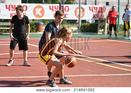 Orenburg, Russia - July 30, 2017 Year: Girls And Boys Play Street Basketball