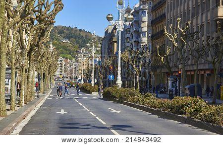 San Sebastian (Donostia) Spain - March 16, 2017. People crossing Avenida de la Libertad Avenue of San Sebastian. Basque Country Guipuzcoa. Spain.