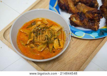 Panang pork Thai local food on white bowl
