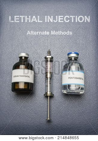 Vintage syringe and drugs used in lethal injection on a book of Lethal Injection, digital composition, conceptual image