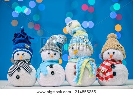 Snowman puppet for merry xmas on blue background