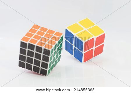 background, blue, brain, brainteaser, capacity, classic, color, colorful, conundrum, cube, dice, editorial, enigmatic, entertainment, erno, facilities, game, green, hungarian, illustrative, intellection, intellectual, intelligence, invented, isolated, lei