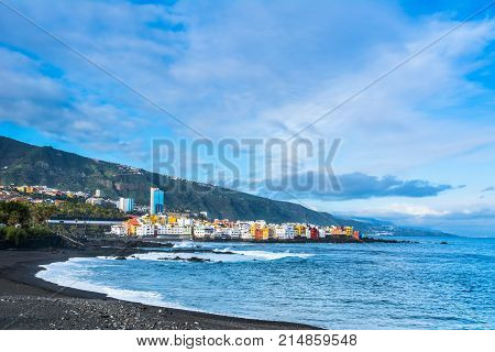 View of colourful houses of Punta Brava from beach Jardin in Puerto de la Cruz Tenerife Canary Islands Spain