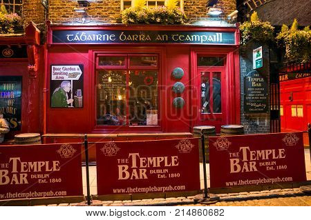 DUBLIN IRELAND - FEB 15 2014: The Temple Bar pub. Temple Bar historic district is known as Dublin's cultural quarter with lively nightlife.