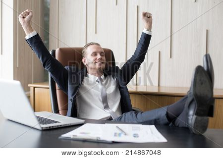 Businessman Sitting With Relax Feeling At Office, Man Finishing Up A Work, Man With Leader Concept.