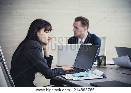 Asian business woman feeling bored with meeting. People working Concept. Vintage Tone.
