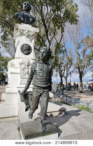 LISBON, PORTUGAL - NOVEMBER 4, 2017: Close-up on a monument to Eduardo Coelho at Sao Pedro de Alcantara viewpoint (Miradorou) in Bairro Alto neighborhood