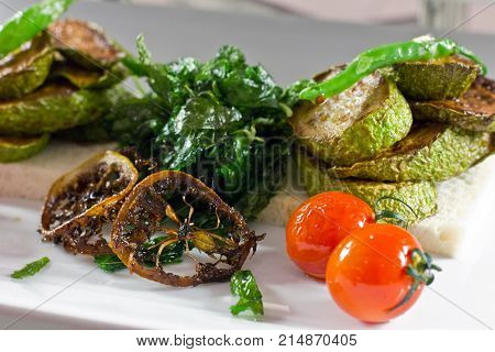 Baked Zuccini  With Cherry Tomatoes And Green Pepper On A White Bread. Baked Lemon