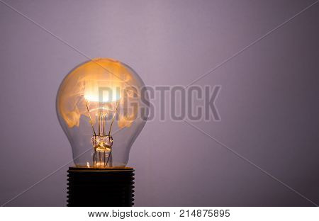 Glass Bulb With Orange Fire Inside From The Light Wire
