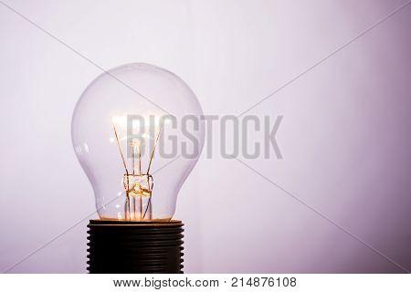 Turned On Glass Bulb On Light Background_