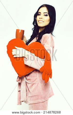 Smiling Girl In Pink Velour Home Suit With Pillow Heart