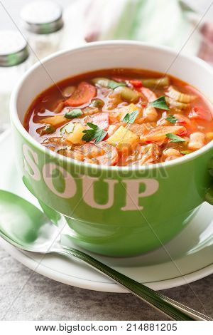 Italian Minestrone Soup In Bowl On Gray Stone Background