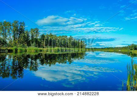 Cloudy reflection The Narrows Provincial Recreation Area, Alberta, Canada
