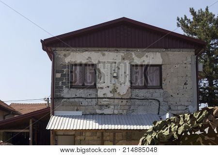 SARAJEVO, BOSNIA AND HERZEGOVINA - AUGUST 19 2017: Back of the famous ruined house that host the Tunel Museum in Sarajevo damaged by the war attacks
