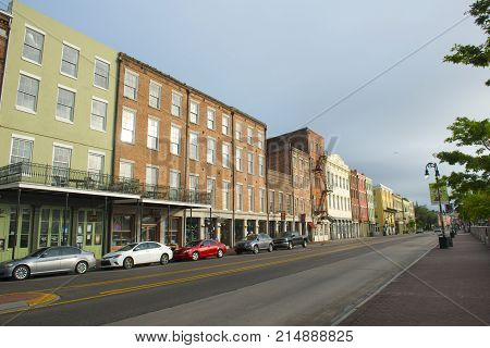 NEW ORLEANS - MAY. 31, 2017: Historic Buildings on North Peters Street between Bienville Street and Iberville Street in French Quarter in New Orleans, Louisiana, USA.