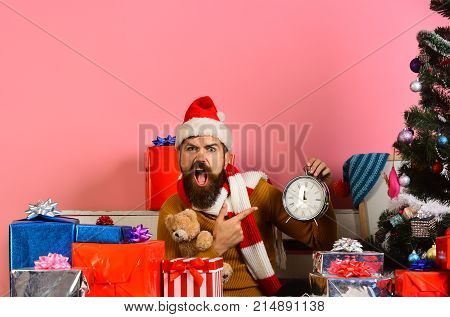 Santa Claus Waits For New Year Near Decorated Tree