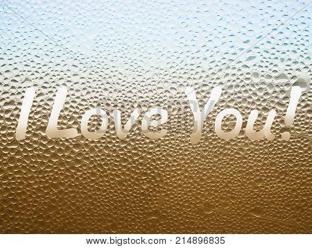 Inscription I Love You! on the sweaty glass