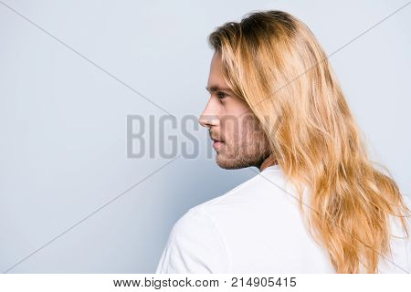 Close Up Half Turned Side View Photo Of Young Stylish Handsome Man With Bristle And Long Clean Smoot