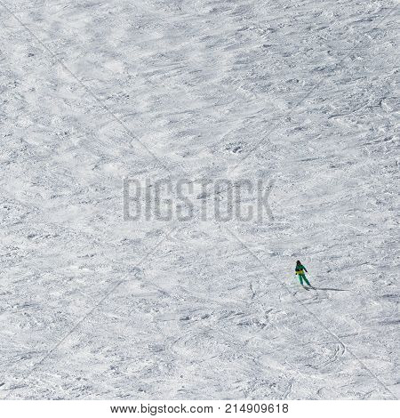 Skier Downhill On Snowy Slope