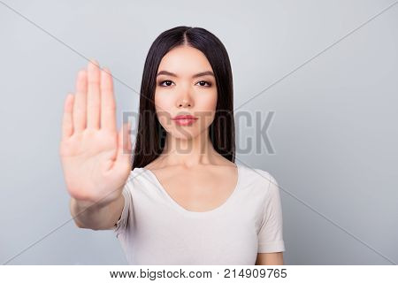 Prohibition Symbol. Closeup Portrait Of Young, Serious, Pretty Girl Making Stop Sign With Her Hand
