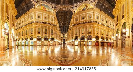 Milan, Lombardia, Italy - October 24, 2017: One of the world's oldest shopping malls Galleria Vittorio Emanuele II from inside the arcade at night in Milan. Panoramic view