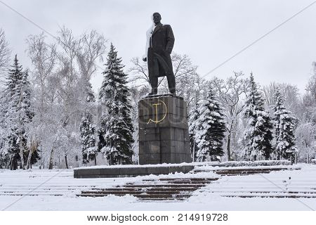 Monument to the communist leader Lenin in a snow-capped city. Makeevka Ukraine