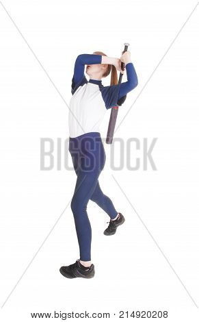A young slim woman playing softball swinging her bad to hit the ball in a blue uniform isolated for white background