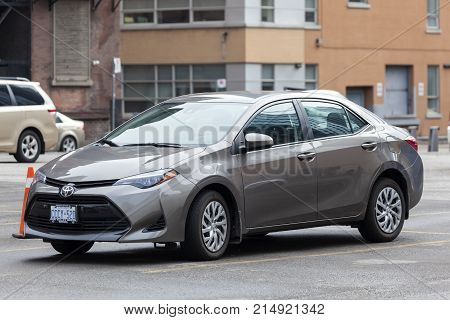 Toronto Canada - Oct 14 2017: Eleventh-generationToyota Corolla on a parking lot in the city of Toronto. Toyota Corolla is one of the best-selling cars in the world.