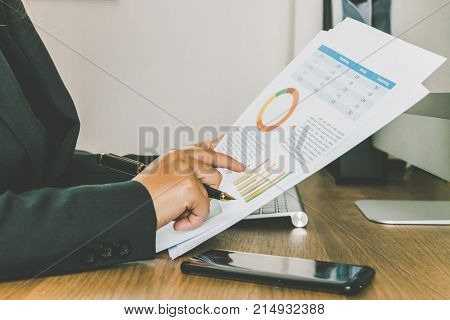 Close-up Businesswoman Reading And Checking Turnover Documents On Her Desk, Businiess Concept