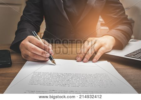 Business Man Signing Terms And Agreement Document On Workingspace, Business Signing Concept