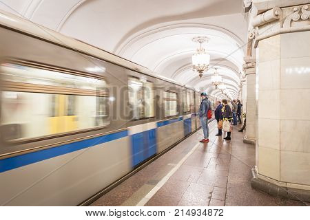 Moscow Russia - September 23, 2017: Blurry motion of arriving Metro at platform that passengers waiting for inside Moscow Metro system.