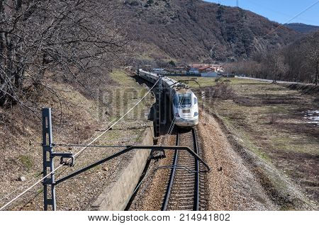 Medium distance train on an Iberian gauge railway track between Leon and Gijon on its way through La Pola de Gordon Leon Province Spain on March 6 2015