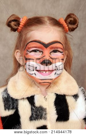 Painted like a tiger the girl's face. Symbol next year