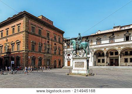 FLORENCE, ITALY - AUGUST 09, 2017: Piazza della Santissima Annunziata, square with the bronze Equestrian statue of Ferdinando I de' Medici, Grand Duke of Tuscany and two fountains by Pietro Tacca.