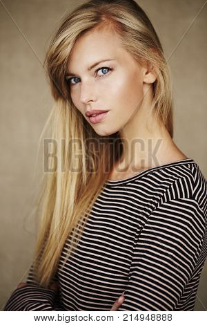 Stunning young blond woman in striped top portrait