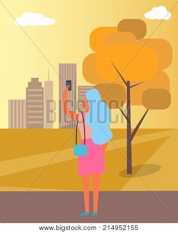 Woman taking picture of autumnal city which includes buildings and trees, sunset and sky and taking some selfies in park vector illustration