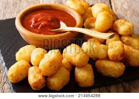 Deep-fried Potato Tater Tots And Ketchup Close-up. Horizontal