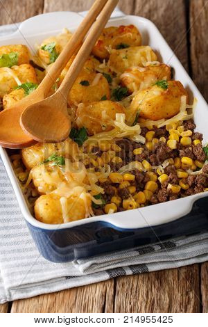 Baked Tater Tots With Ground Beef, Corn And Cheese Close-up. Vertical