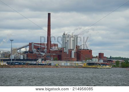 KOTKA, FINLAND - JUNE 03, 2017: Sunila pulp and paper mill close up in the cloudy June afternoon
