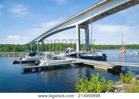 PUUMALA, FINLAND - JUNE 17, 2017: Sunny June day at the automobile bridge on the Saimaa lake