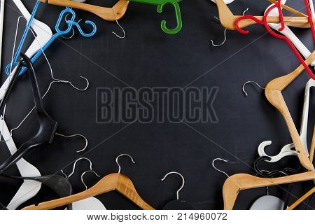 Black Friday shopping sale concept. Clothes hangers with copy space on black background.