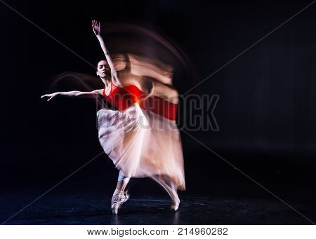 Grace and elegance. Nice beautiful attractive woman closing her eyes and dancing while being involved in the activity