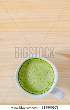 Milk Green Tea On Wooden Table