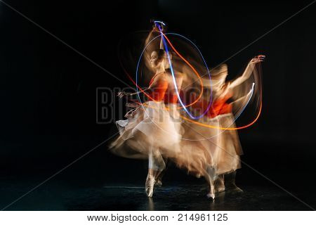Dance class. Attractive gracious skillful woman doing dance figures and smiling while practicing her dance