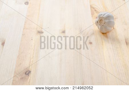 The fresh Garlic on wooden table background