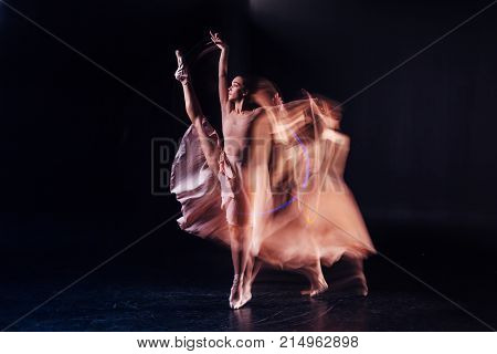 Professional female dancer. Serious nice well built woman holding her leg up and showing her mastery while dancing