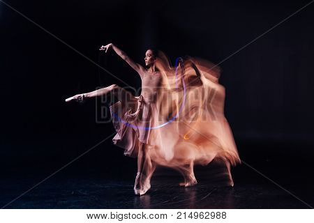 Dress rehearsal. Professional nice female dancer standing on stage and doing the movements while getting ready to the performance