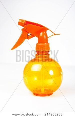 Watering Can plant spray vaporisateur spray bottle of water on white background. Spray bottle. Water gun. Foggy. Can be used to water plants. Multifunction. Orange.